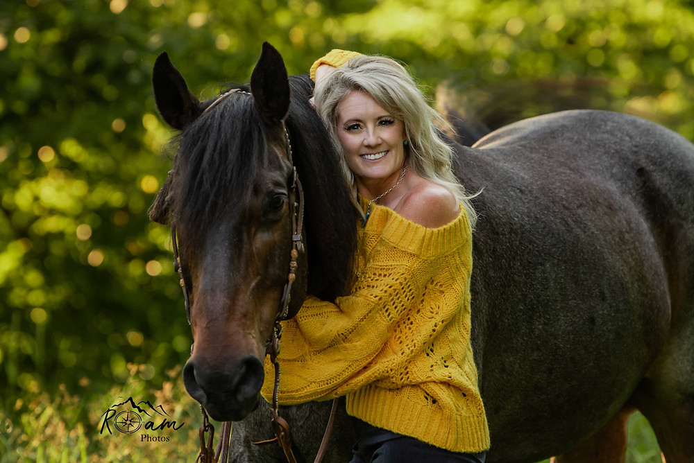 Beautiful cowgirl with her horse