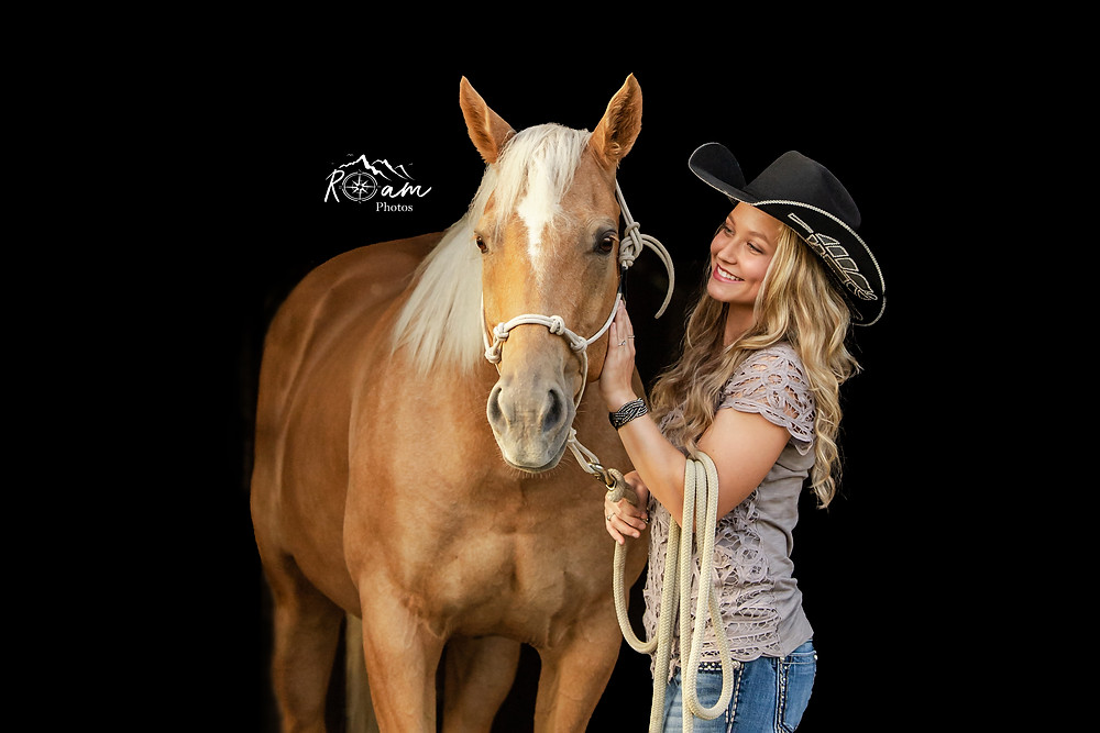 Beautiful cowgirl and palomino horse
