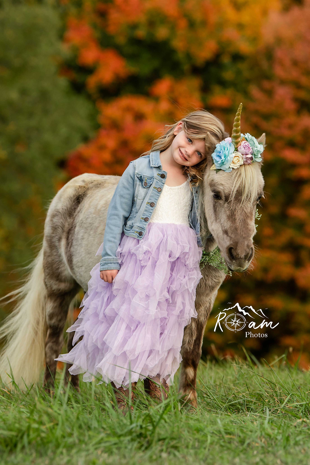 Little girl leaning on a pony unicorn