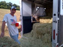 taking a break after loading hay