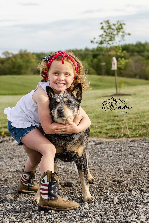 Little girl hugging her dog.