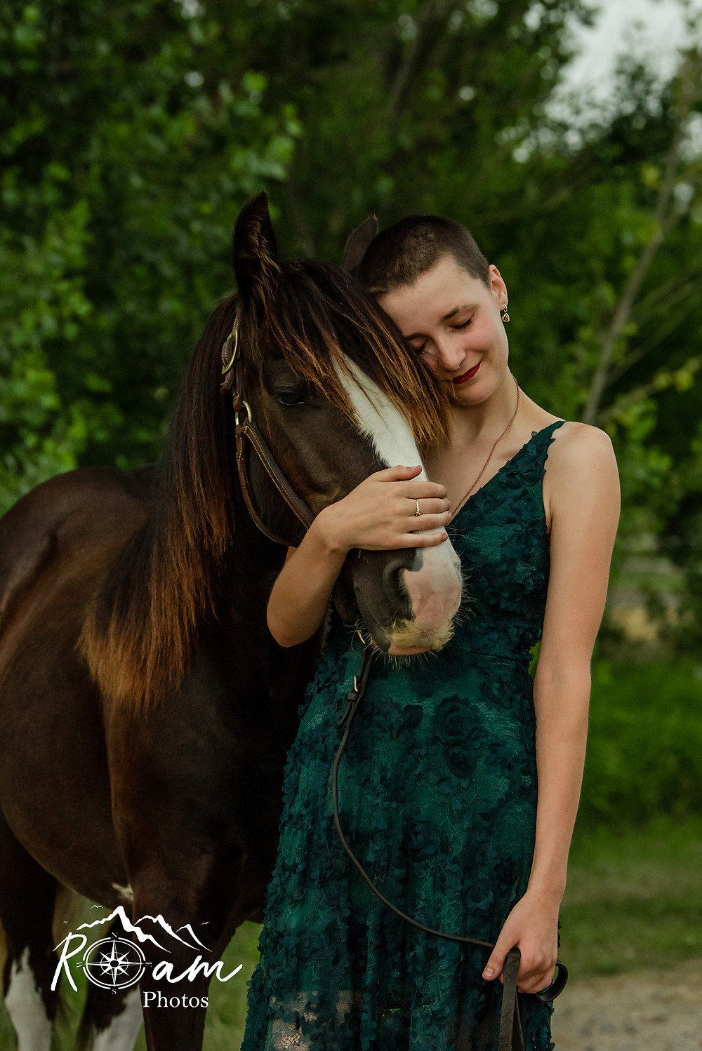 Girl loving on her horse with closed eyes