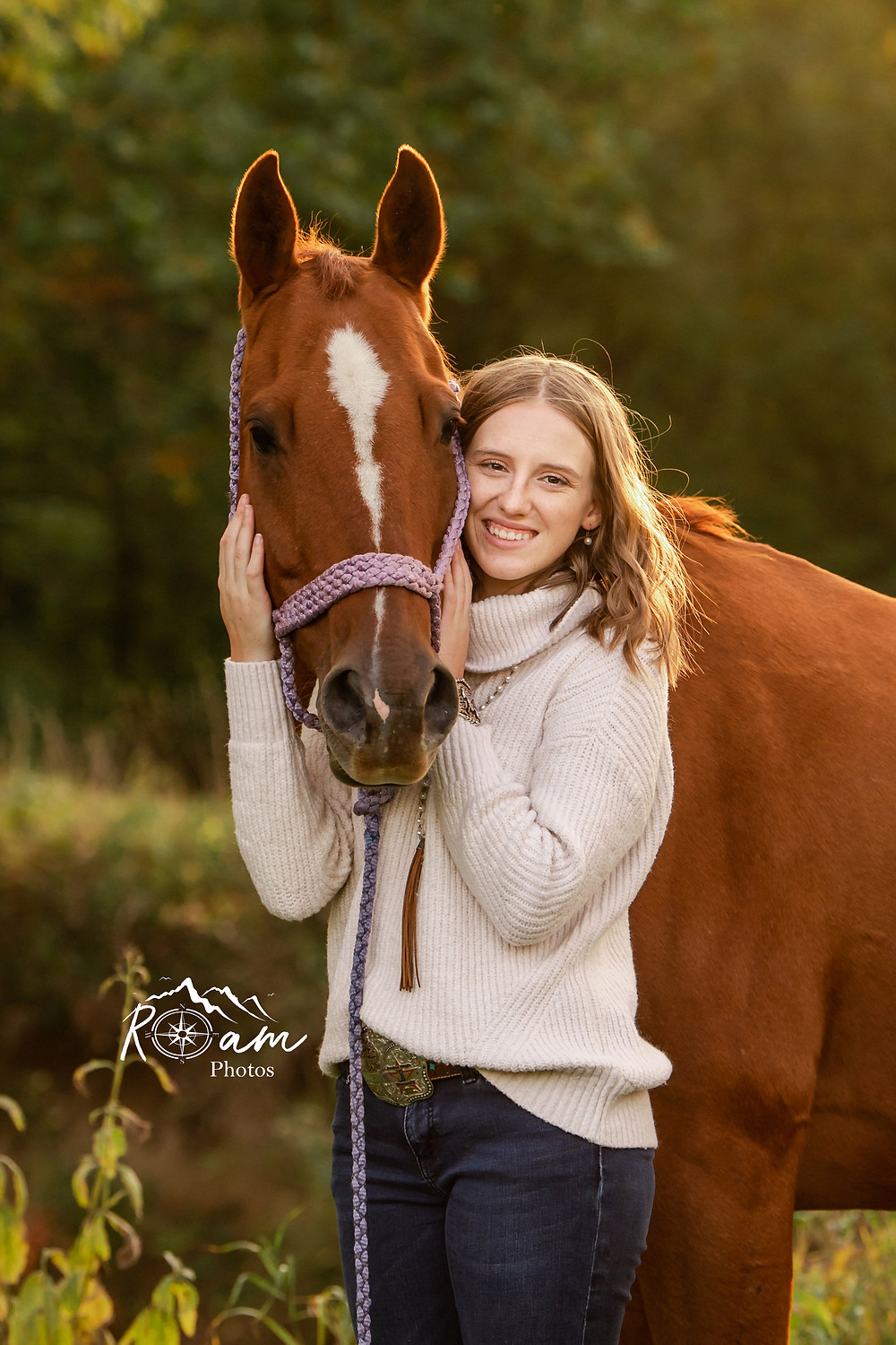 Young girl hugging her horse. Senior photos