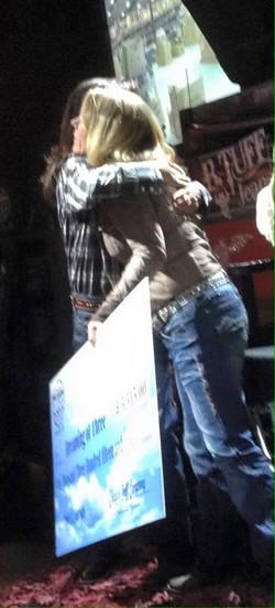 Lisa Lockhart hugging Jackie at Tuff
