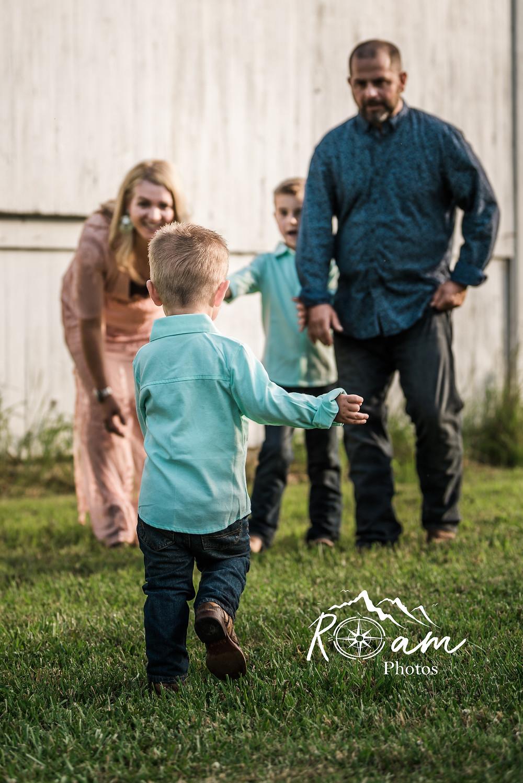 little boy running to family