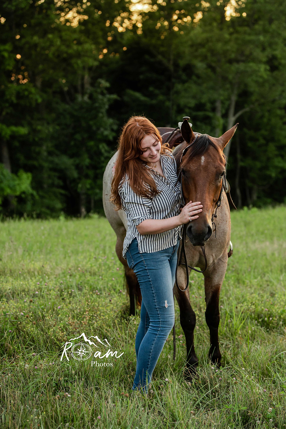 Pretty red headed girl with her horse.