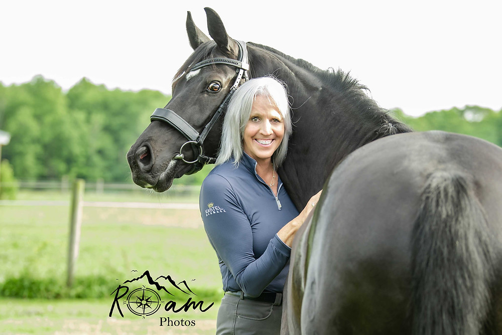 Pretty mature lady with black horse.