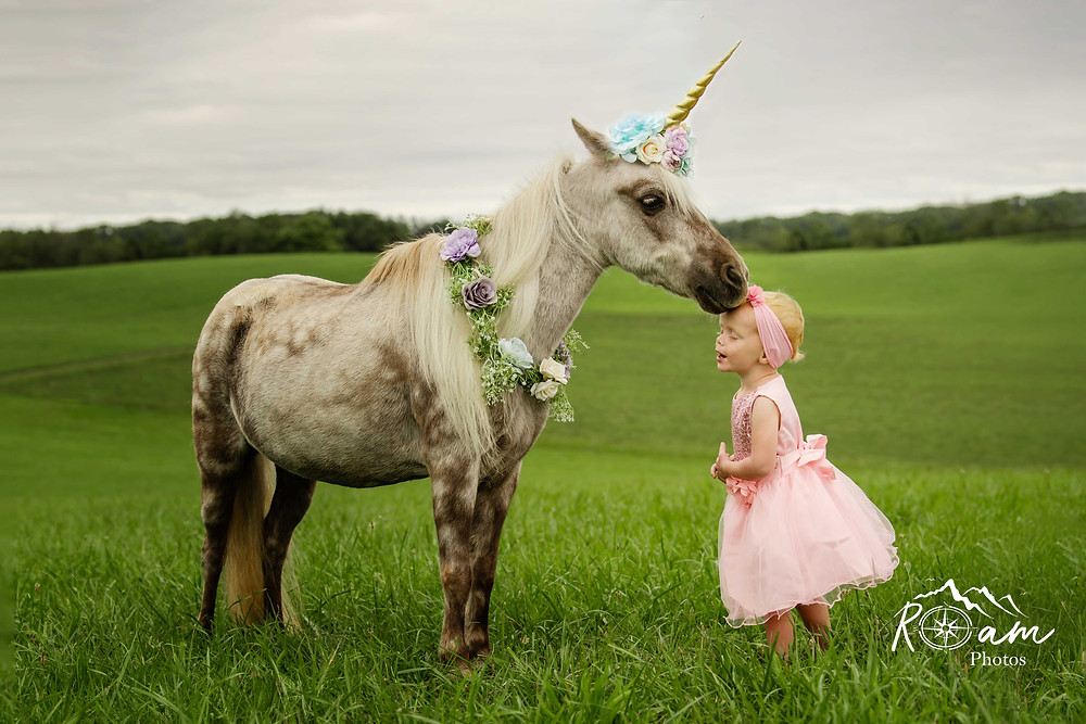 Pony kissing little girl on the forehead