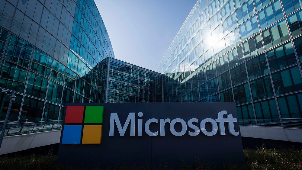 FILE PHOTO: A Microsoft logo is seen a day after Microsoft Corp's $26.2 billion purchase of LinkedIn Corp, in Los Angeles, California, U.S., on June 14, 2016.