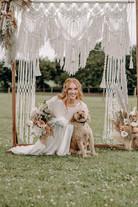 Bride with dog under macrame arch