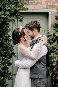 Bride and Groom, couple, couple getting married, garden wedding, ceremony, bridal hair, hair accessories, wedding dress
