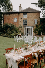 Garden party wedding, high tea, afternoon tea, vintage table styling, vintage china, cut glass, glassware, garden party, intimate wedding, small wedding, wedding for 30 people, mismatched chairs, wooden trestle tables, table runners, brass candlesticks, wrought iron chairs, wedding ceremony, old house, Georgian house, large garden