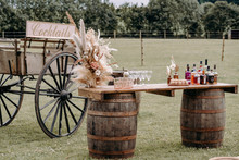 Cocktail bar with florals and cart