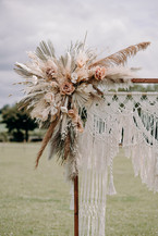 Boho floral display on Macrame arch