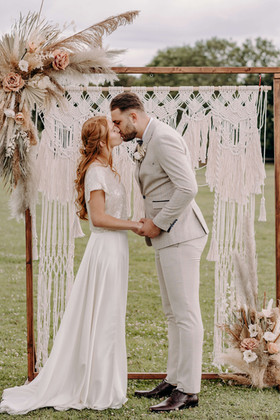 Bride and Groom, first kiss, ceremony arch