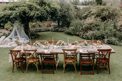 Garden party wedding, high tea, afternoon tea, vintage table styling, vintage china, cut glass, glassware, garden party, intimate wedding, small wedding, wedding for 30 people, mismatched chairs, wooden trestle tables, table runners, brass candlesticks