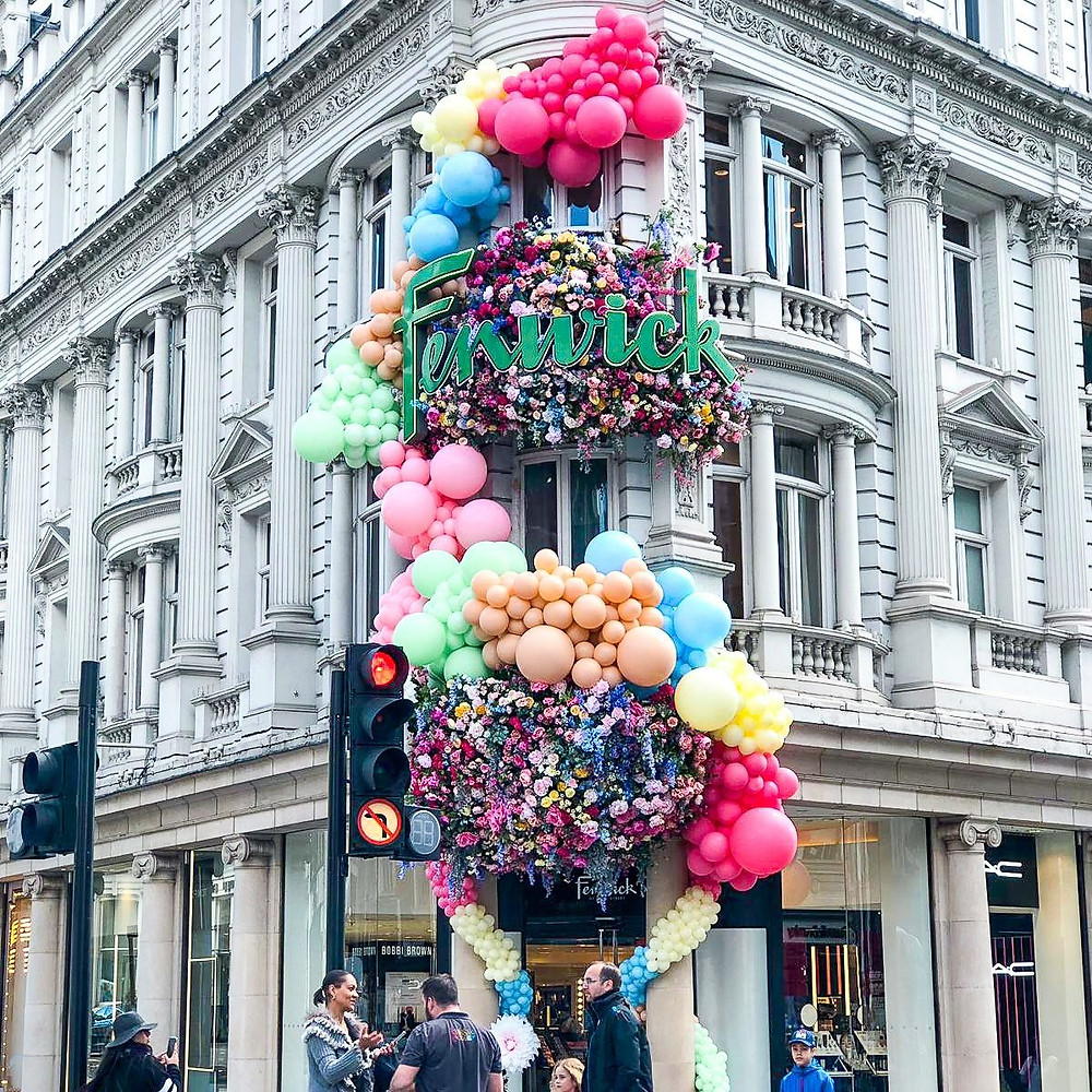 Balloon garland across store front