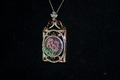 Rose frame pendant rpkotcollection precious stones set in as flowers in a intricate frame the stones used for the flowers are diamonds rubies and emeralds for the leaves aloadofball Choice Image