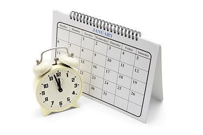 A desk clock and a calendar