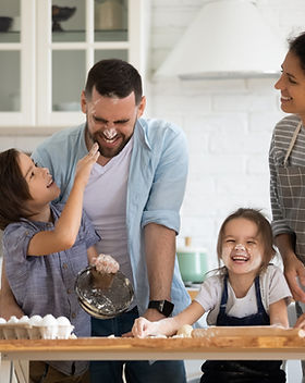 Overjoyed young family with little presc