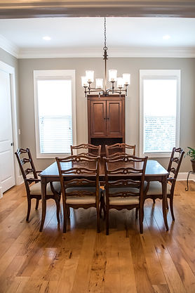 Formal Dining room with a set of wood ta