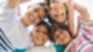 Latino kids circle looking down.jpg