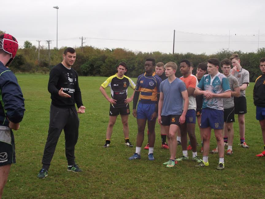 Robbie Henshaw chatting thr Senior rugby team