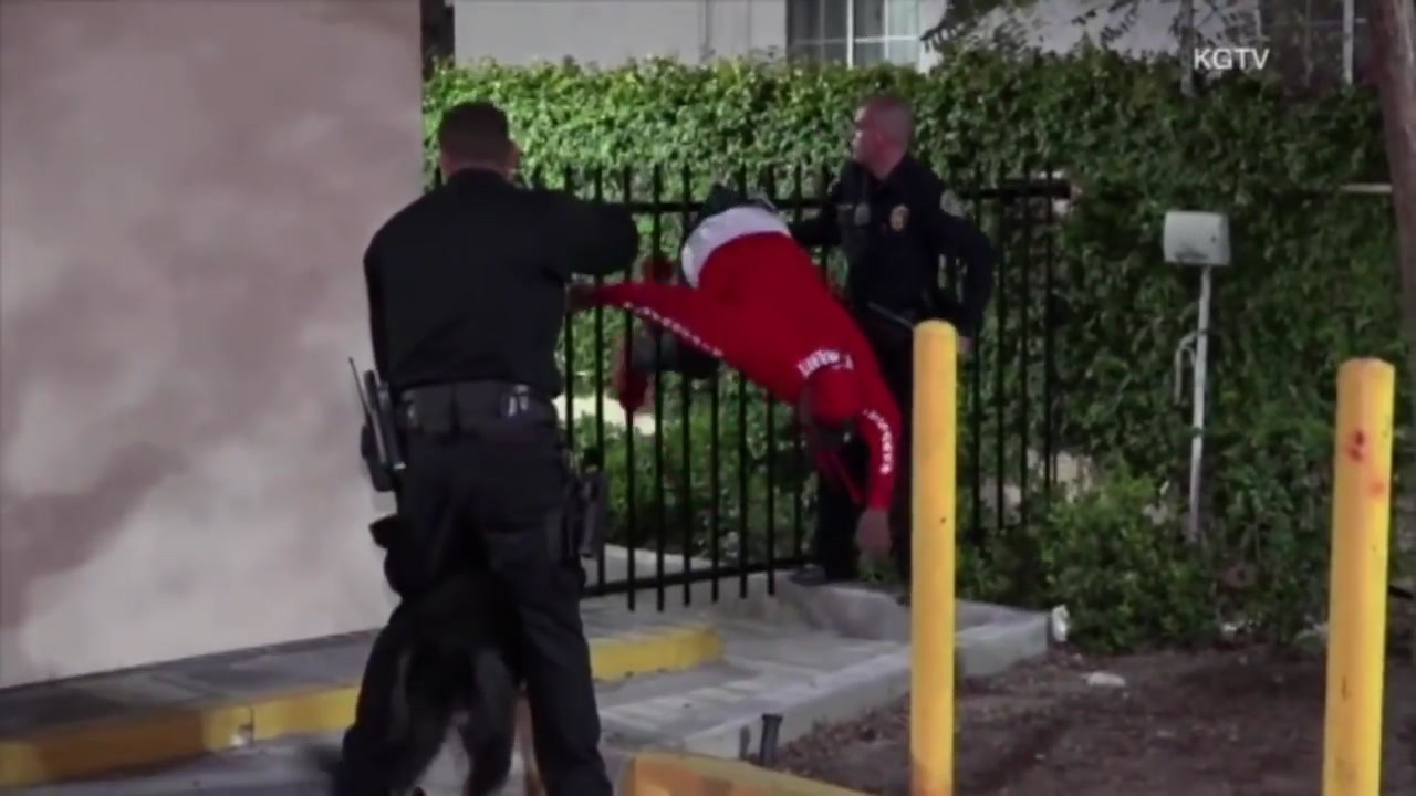 Caught by the seat of his pants: suspect snagged on fence