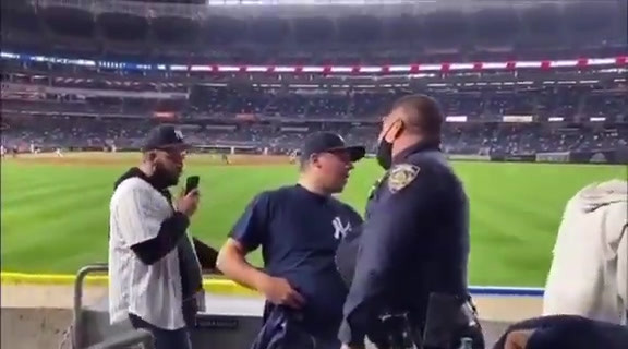 Cop Yanks Yankees Fan by the Seat of his Pants