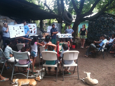 During the last day on the island, the Drs. & vet students present a public health seminar and Q & A for the locals, and distribute information and medicines to help keep them and their animals healthy after we're gone.