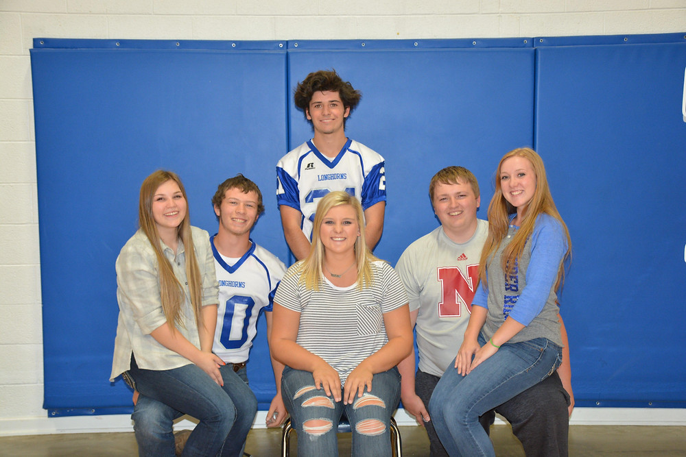 "Left to Right: Cassidy Gillespie, Seth Loyd, Javier ""Kiko"" Moreno Ortega standing behind Kennedy Rietzke, Brock Wallgren, and Morgan Westbrook are the 2017 Football Homecoming Candidates."