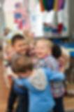 KidsCentre Pre-K diverse group hug