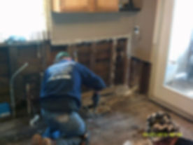 Man restoring flooring in a home from water damage Stanton, MI