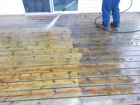 professional pressure washing of a deck in Stanton, MI