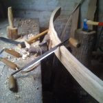 smoothing oak rail using draw knife and