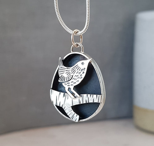 solid silver pendant with wren