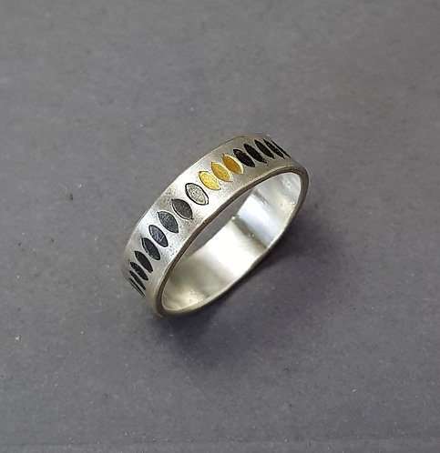 Silver ring with oxidised leaf pattern and 3 gold leaves