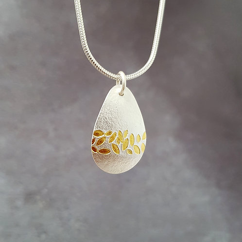 Small silver pendant with gold leaf stripe