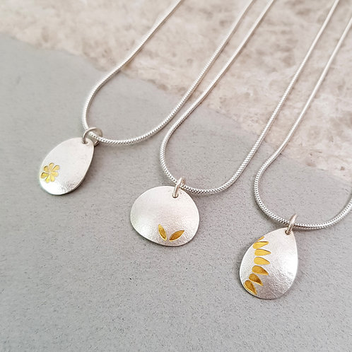 Small gold leaf and fine silver pendants from £72