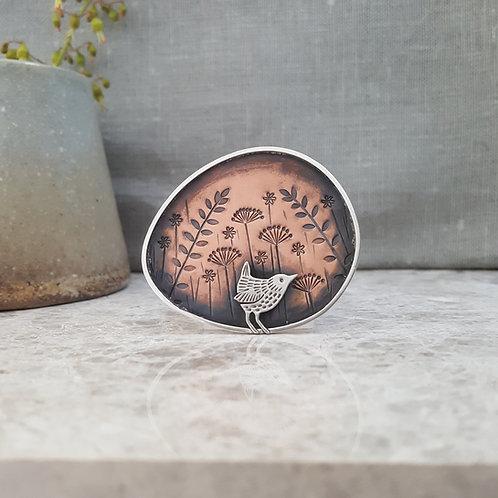 Handmade silver and copper wren brooch
