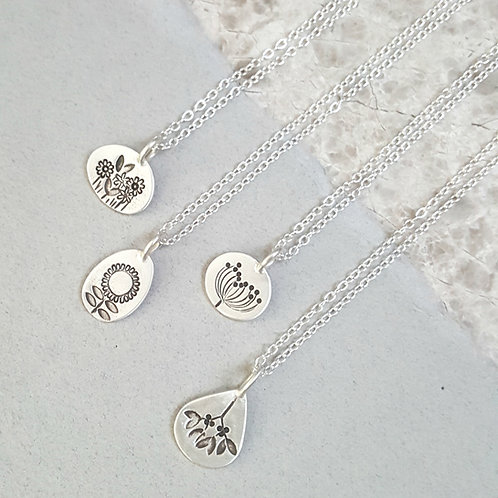 delicate little silver charm necklace