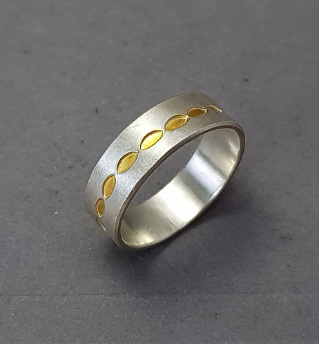 Silver ring with gold leaf
