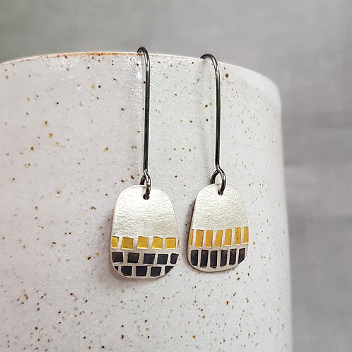 contemporary silver and gold dangle earrings