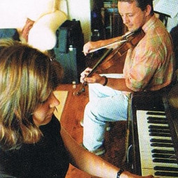 Liza and Bruce having a tune at home