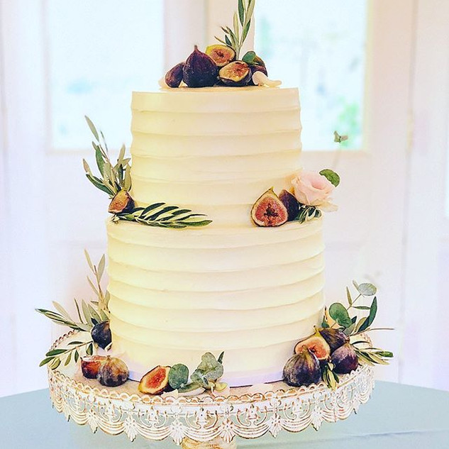 Vanilla Wedding Cake adorned with figs,