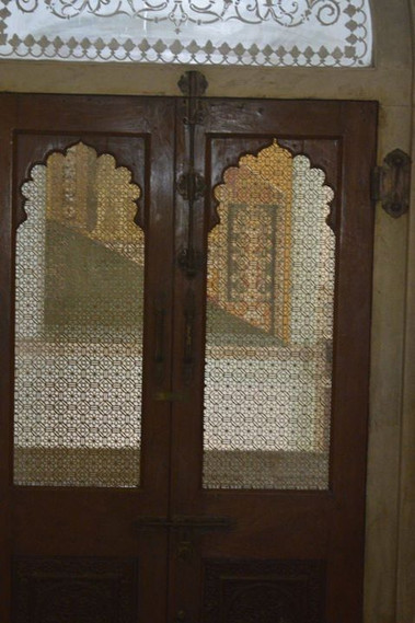 Jali woodwork door - keeps birds and ani