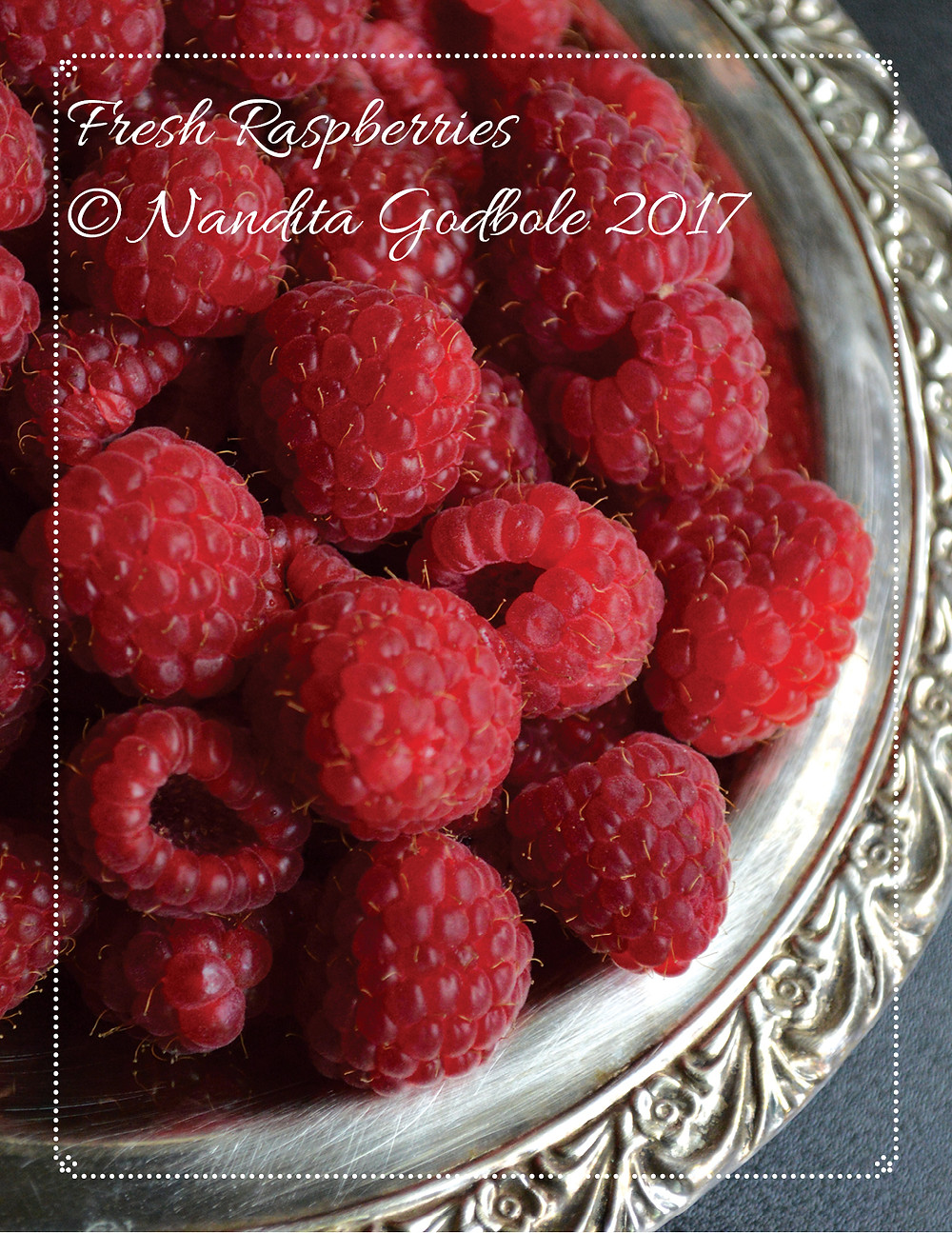 My amateur photography of raspberries.