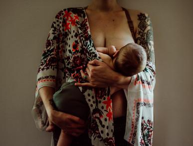 indoor photo session mother nursing baby portrait   elkhorn, wi