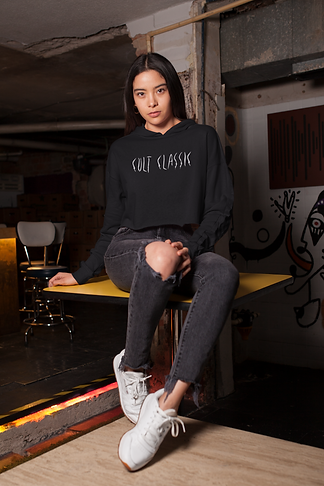 crop-top-hoodie-mockup-featuring-a-girl-sitting-over-an-old-bar-s-table-26105.png