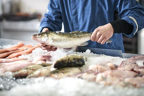Fishmonger selling fish.jpg